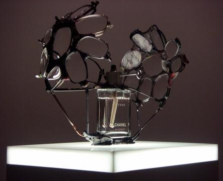 Perfume SOS (lighthouse) 2004. Perfume bottle, eyewear, cotton wick & melted plastic
