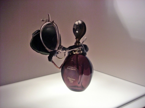 Perfume SOS (Poison Island) 2004. Perfume bottle, eyewear, spoon, cotton wick & melted plastic