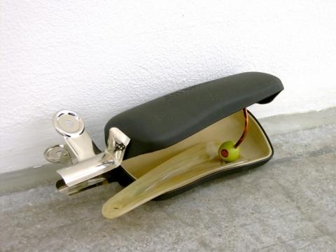 Channel Case Trap 2003. Eyewear case, shoe horn, steel clip & olive