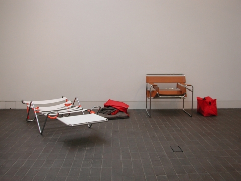 Wassily A&E 2001. Welded steel brackets & first aid blankets, for converting  'Wassily' chairs into emergency stretchers