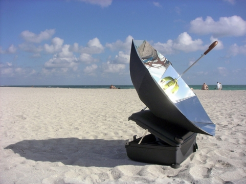 Eternal Solar Dawn, 2004. Umbrella, suitcase, mirror coated aluminium, cutlery & plantains
